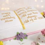 Floral book and teacup cake
